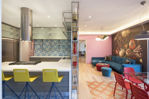 A colorful sitting area off the kitchen with an additional dining area.