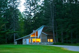 A charming 900-square-foot guest house sits on the property.
