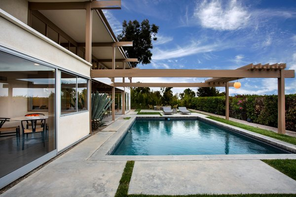 Clean lines and midcentury vibes surround the outdoor pool.