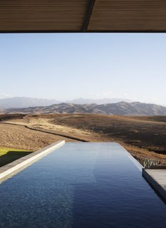 A rectangular infinity pool is set perpendicular to the facade, making it the perfect spot for cooling off in the Moroccan heat.