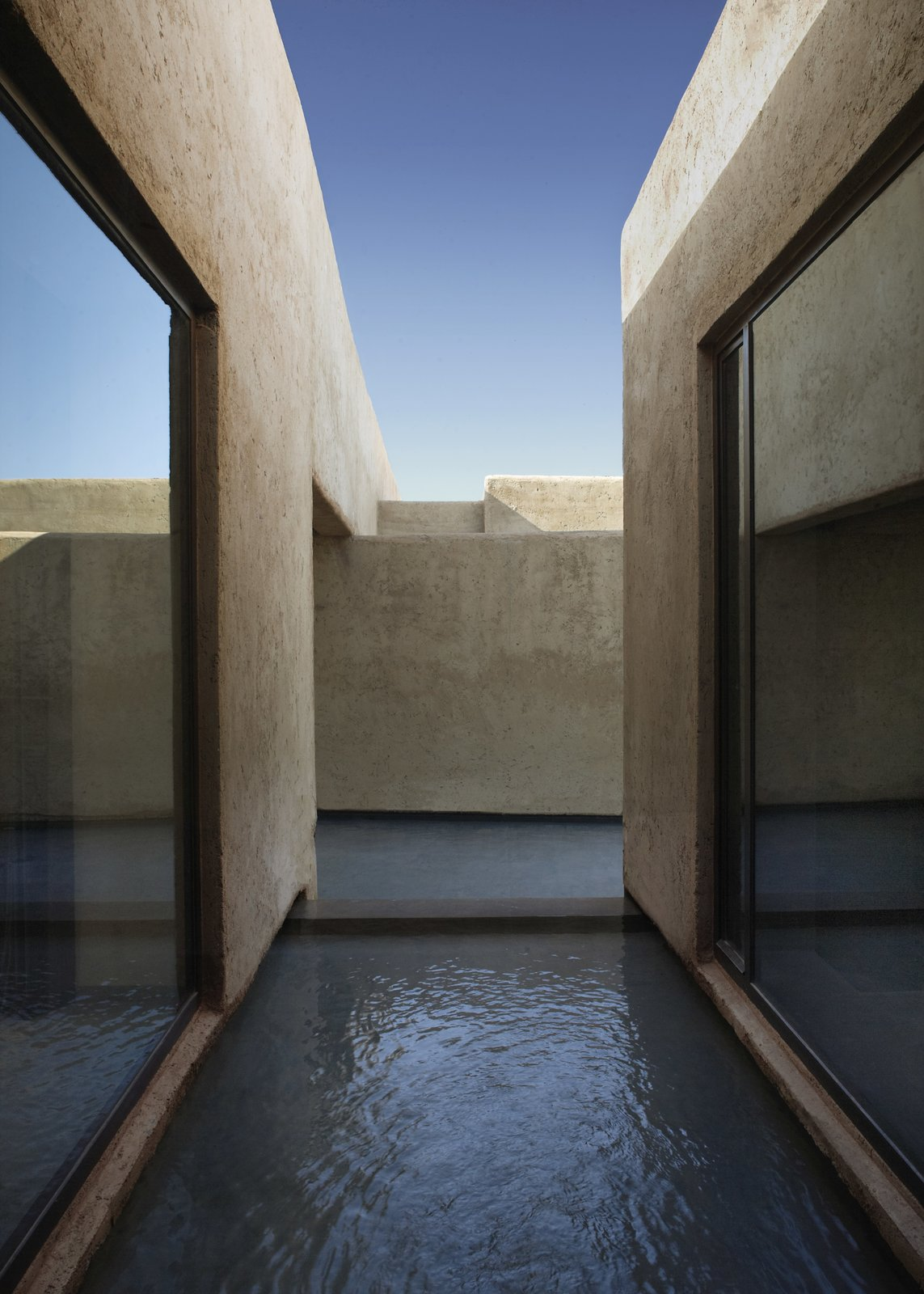 Outdoor, Side Yard, Small Pools, Tubs, Shower, and Concrete Fences, Wall The geometric volumes reference local building traditions.     Photo 5 of 8 in Soak Up the Sun at This Spectacular Moroccan Retreat