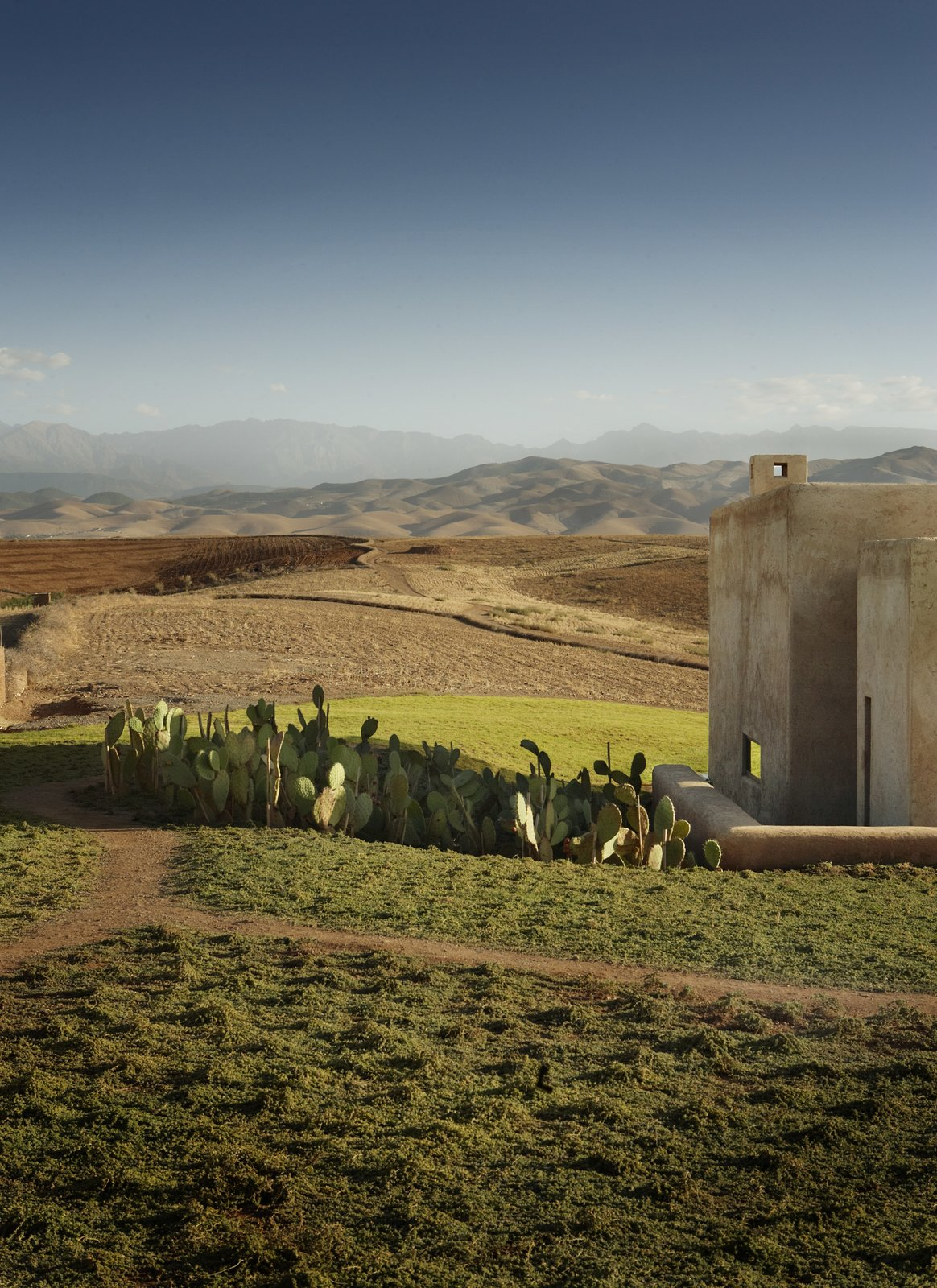 Outdoor and Grass Surrounded by bucolic countryside scenery, the villa is only 25 minutes from Marrakech.     Photo 7 of 8 in Soak Up the Sun at This Spectacular Moroccan Retreat