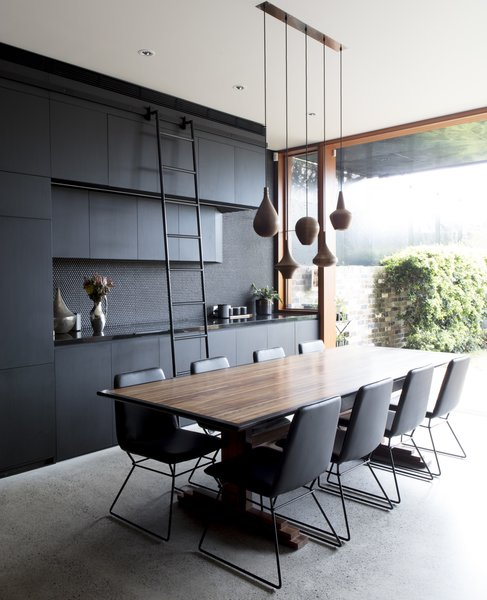 The full-height sliding glass doors have been added to mediate the threshold between the garden and house.