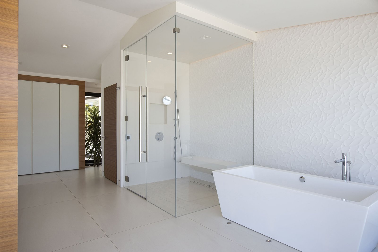 Bath Room, Ceramic Tile Floor, Freestanding Tub, Enclosed Shower, Soaking Tub, and Recessed Lighting The master bath.  Photos from A Renovated Midcentury in San Diego Is Sharp and Sustainable