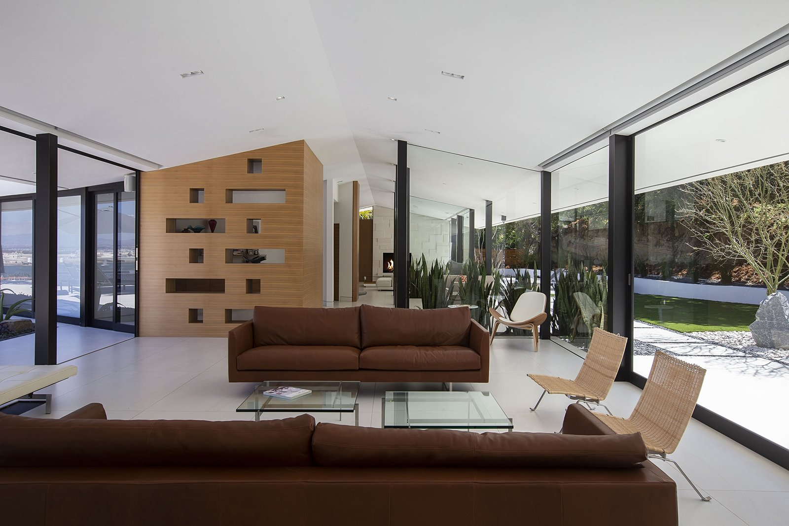 Living, Standard Layout, Sofa, Chair, Recessed, Coffee Tables, Ceramic Tile, and Bench Walls of glass create a seamless flow—integrating the home into its surroundings.  Best Living Standard Layout Bench Photos from A Renovated Midcentury in San Diego Is Sharp and Sustainable