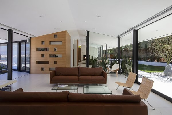 Walls of glass create a seamless flow—integrating the home into its surroundings.
