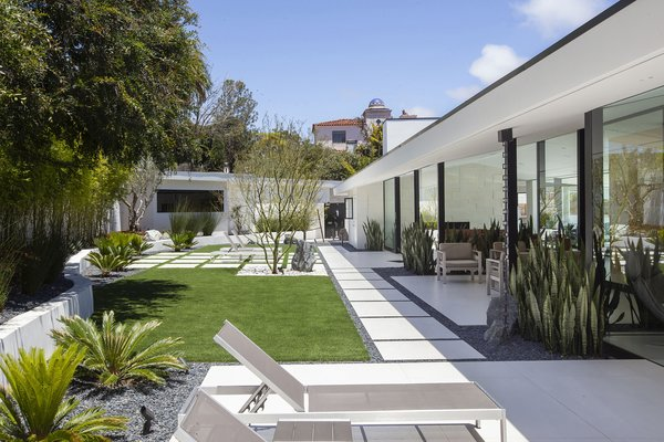 Low irrigation plants and minimalistic hardscapes form the serene outdoor space.