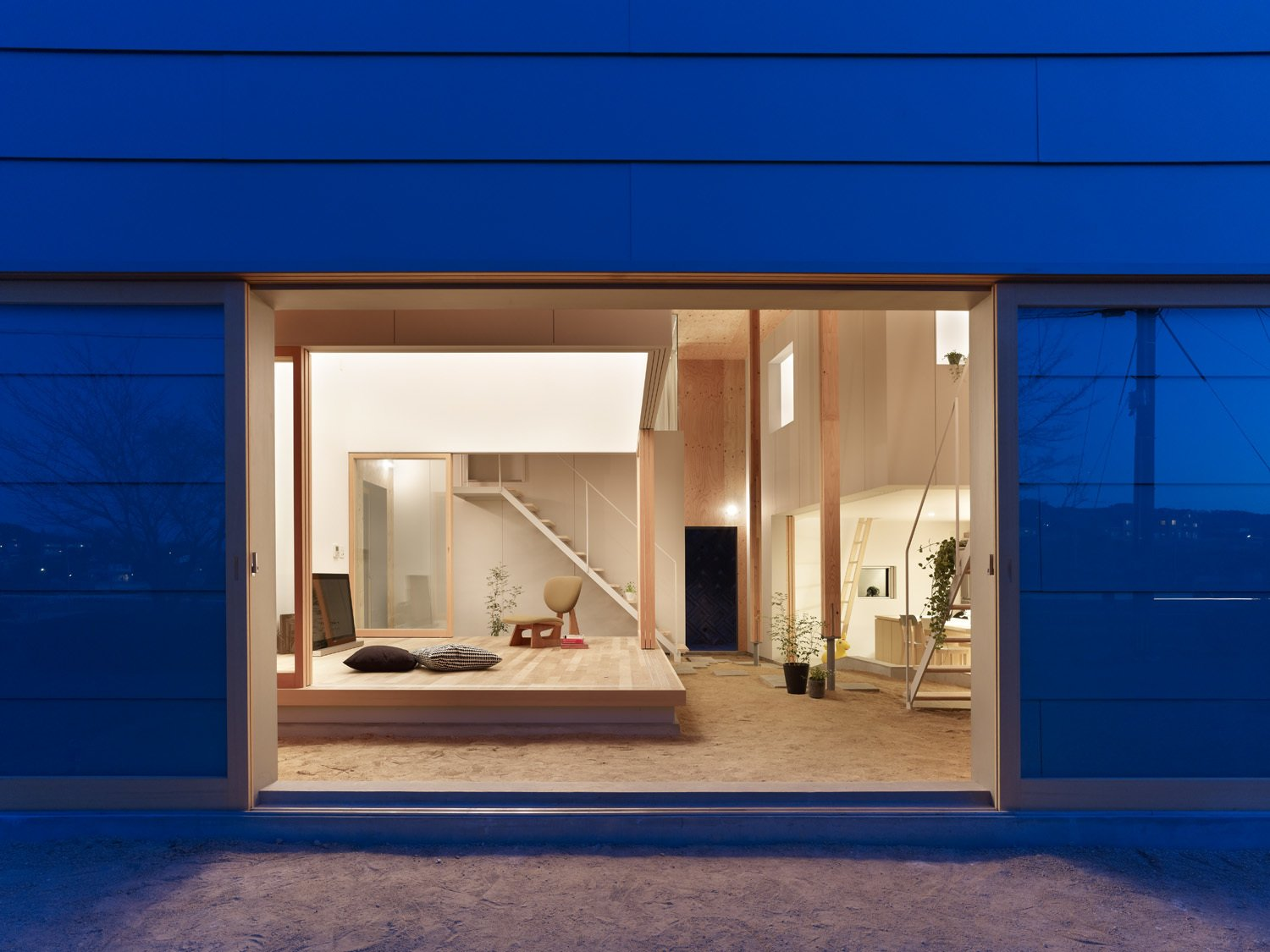 """Doors and Exterior """"We hope that in time the house will make the client's lifestyle better by providing spaces that can change as they progress in life, much like how an outdoor space constantly changes with the environment,"""" say the architects.  Photos from A Dirt Floor Snakes Through This Spectacular Japanese House"""