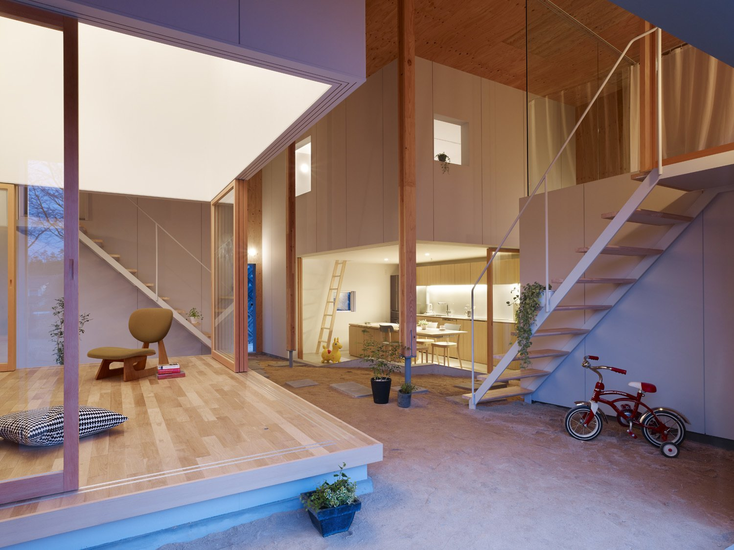 "Living, Light Hardwood, Chair, Table, Recessed, and Concrete The space also allows for traditionally ""outdoor"" items, like a child's bicycle, to be stored or even used inside.   Best Living Concrete Light Hardwood Photos from A Dirt Floor Snakes Through This Spectacular Japanese House"