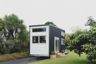 The Buster Tiny House is a customizable model from Build Tiny, a family-owned business that constructs exquisite tiny homes from their own workshop in Katikati, New Zealand. Featuring a lofty living space, lots of natural light, and a surprising amount of storage, this model is sheathed in two-tone corrugated metal and can be ordered either finished or unfinished, giving buyers customization options to meet their own specific needs. The basic shell starts at around $37,885 (NZ $55,600), with a turn-key version is priced at $69,845 (NZ $102,500).