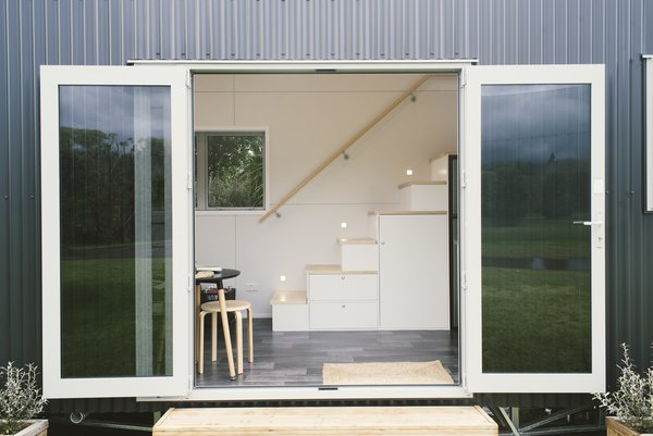 French doors form the entrance to this mini abode.