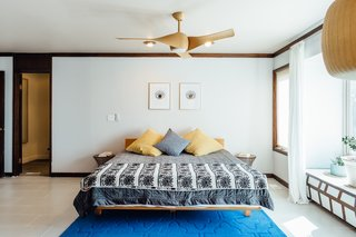 This midcentury bedroom employs a period piece for a ceiling light: the Artemis maple ceiling fan with an incorporated LED light honors the period with organic, undulating forms.