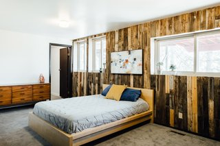 A wood-paneled guest room.