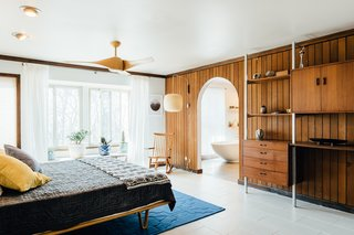 An arched doorway leads to an ensuite master bath.