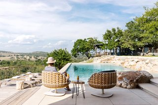 The pavilion overlooks the 60-foot long lap pool which was built into the hillside with a stunning roughhewn exposed stone ledge.