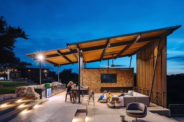 Attached to the pool is a single pitch steel-framed pavilion with an outdoor kitchen and dining area. The shelter provides additional outdoor living space for the family to congregate.