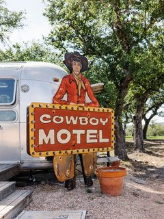"""Ample space for guests includes a refurbished 1976 """"Texas Motel"""" Airstream—and the family has plans for additional guest quarters in the works."""