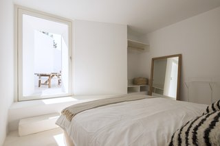 The elegant bedrooms feature large pendulum doors that also act as windows.
