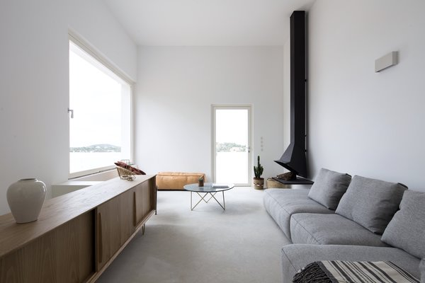 The cool midcentury fireplace was designed in 1965 by Spanish architects Alfonso Mila and Federico Correa.