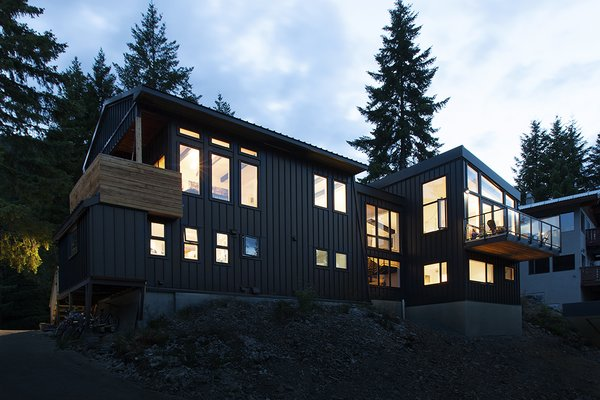 """The exteriors of the two structures, the updated cabin, and the """"modern box"""" addition were tied together with a standing seam metal facade. This helped give the connected complex a contemporary, industrial-inspired vibe."""