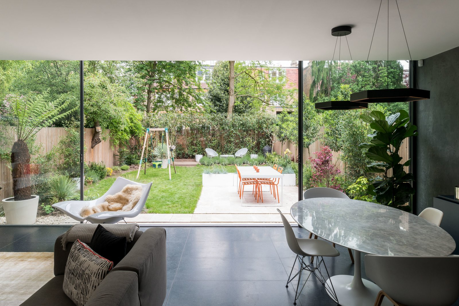 Dining, Table, Pendant, Chair, and Terrazzo Huge floor-to-ceiling sliding doors flood the space with light, and create a seamless connection to the outdoors.    Best Dining Pendant Terrazzo Photos from A Swoon-Worthy London Apartment Is Listed For £1.8M