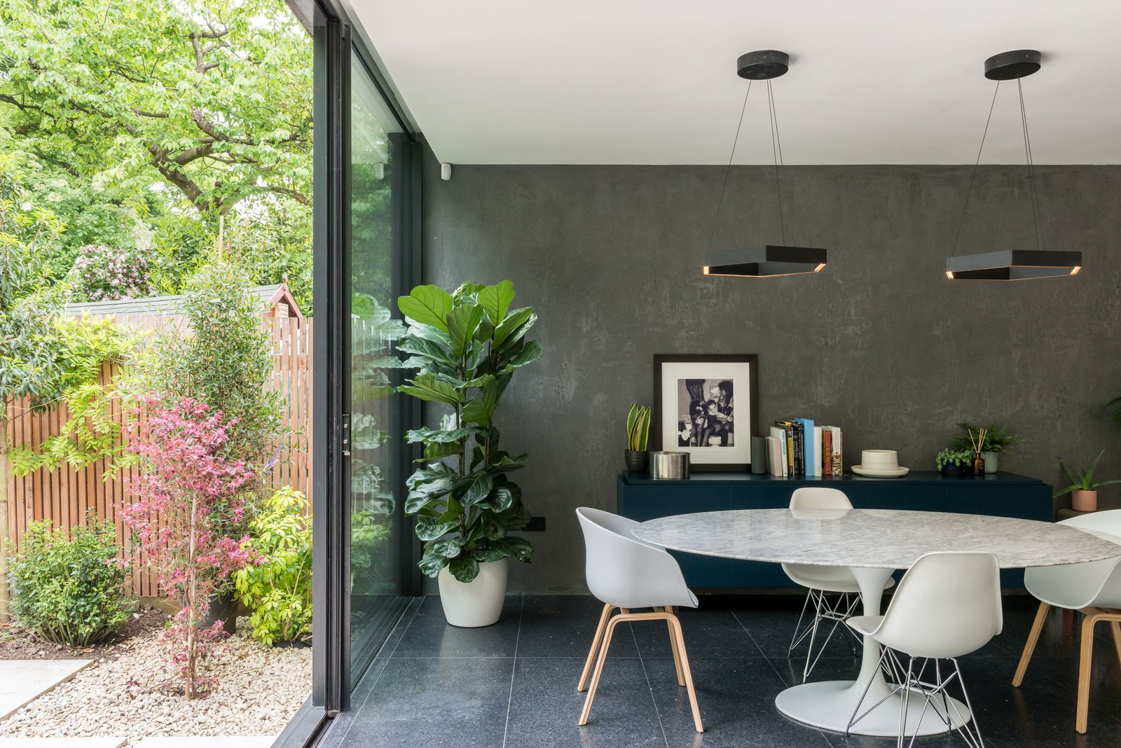 Dining Room, Terrazzo Floor, Table, Chair, and Pendant Lighting The mix of materials feels chic and polished, while also cultivating a natural, earthy vibe.     Photo 9 of 11 in A Swoon-Worthy London Apartment Is Listed For £1.8M