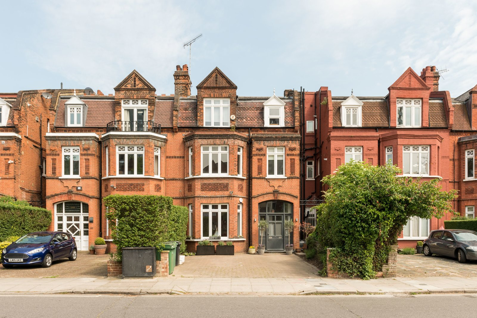 Exterior, Brick Siding Material, Shingles Roof Material, Gable RoofLine, and Apartment Building Type The traditional facade does little to hint at the apartment's modern aesthetic.  Photo 1 of 11 in A Swoon-Worthy London Apartment Is Listed For £1.8M