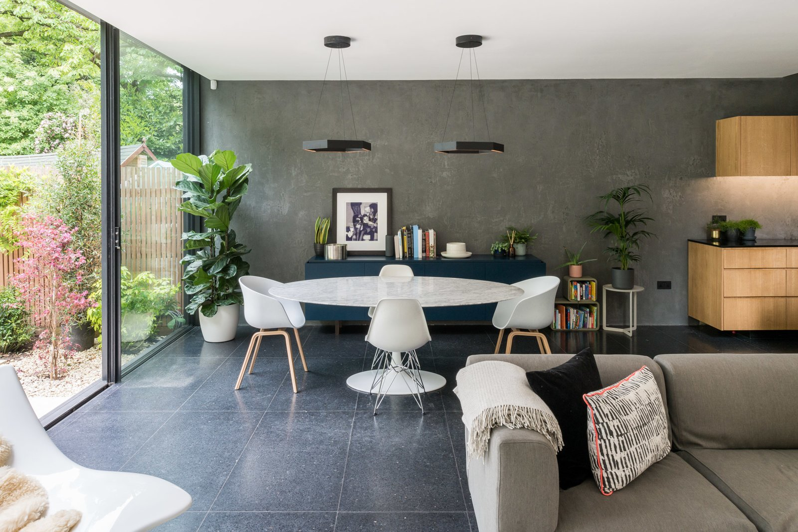 Dining, Table, Pendant, Storage, Chair, and Terrazzo A wall of polished plaster extends to the rear, accentuating the ceiling height and adding a raw, textured finish to the otherwise polished interior space.     Best Dining Storage Terrazzo Photos from A Swoon-Worthy London Apartment Is Listed For £1.8M