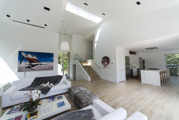 The glass entryway of the home opens straight into the living room.