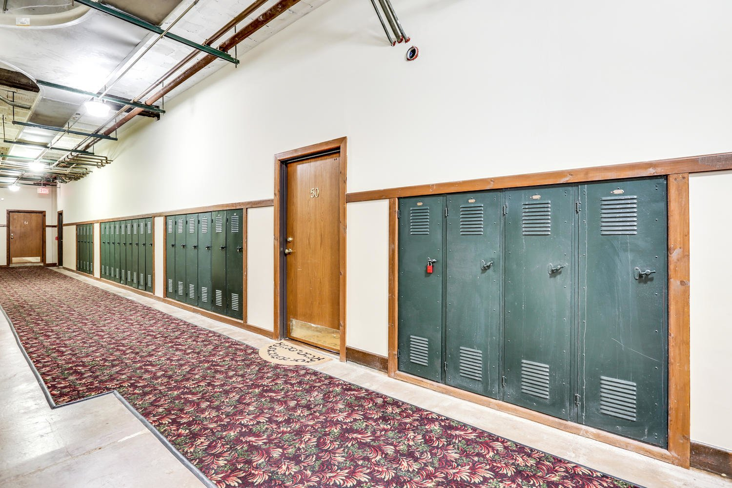 Hallway and Carpet Floor Lockers remain in the hallways of Leland lofts, adding to the character of the turn-of-the-century former schoolhouse.     Photo 9 of 9 in Grab This Dazzling Detroit Loft in a Historic School Building For $450K