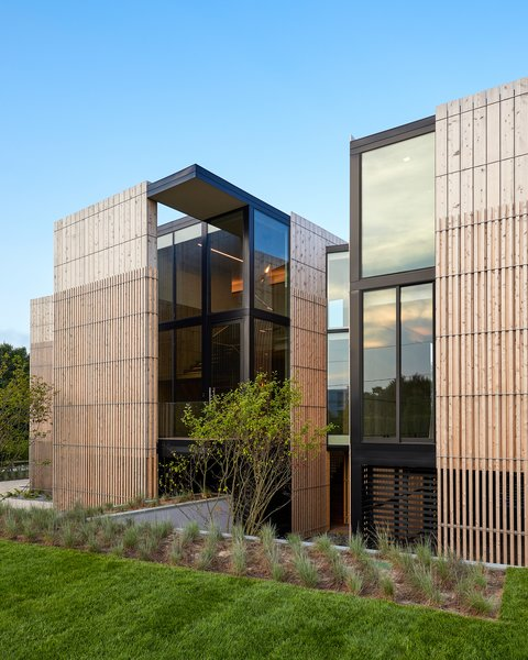 The exterior of the home is layered for privacy and shade. Alaskan cedar siding adds an elegant and dramatic modern touch.