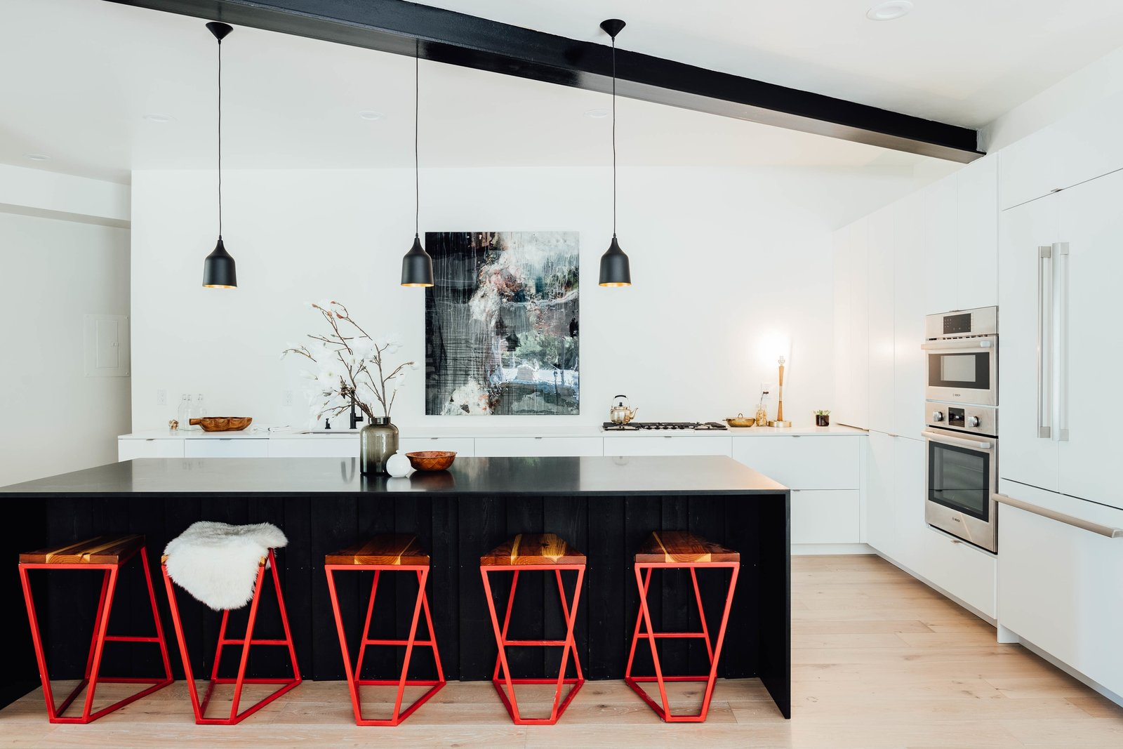 Kitchen, Wall Oven, Refrigerator, White, Light Hardwood, Pendant, Cooktops, Undermount, Table, and Recessed A closer look at the lovely lines of the clean, modern kitchen.     Best Kitchen Photos from This Passive House in Park City Just Hit the Market For $1.1M