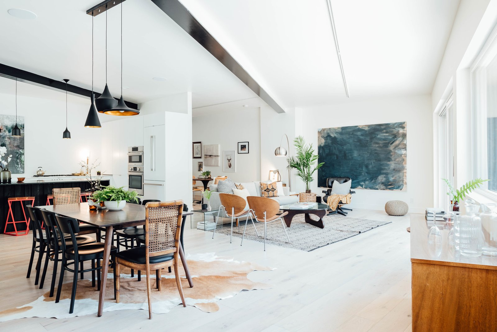 Living Room, Sofa, Ceiling Lighting, Chair, Rug Floor, Stools, Table, Coffee Tables, Pendant Lighting, Light Hardwood Floor, and Recessed Lighting The open-plan layout is a fitting setting to embrace a minimalist, Scandinavian-inspired aesthetic.     Best Photos from This Passive House in Park City Just Hit the Market For $1.1M