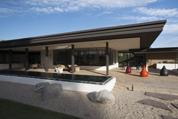 "Pereira's modernist ranch for Firestone combined ""the strength of his commercial work with the lightness that desert living demanded."" The timeless home still looks every bit as contemporary today as it did when it was originally built."