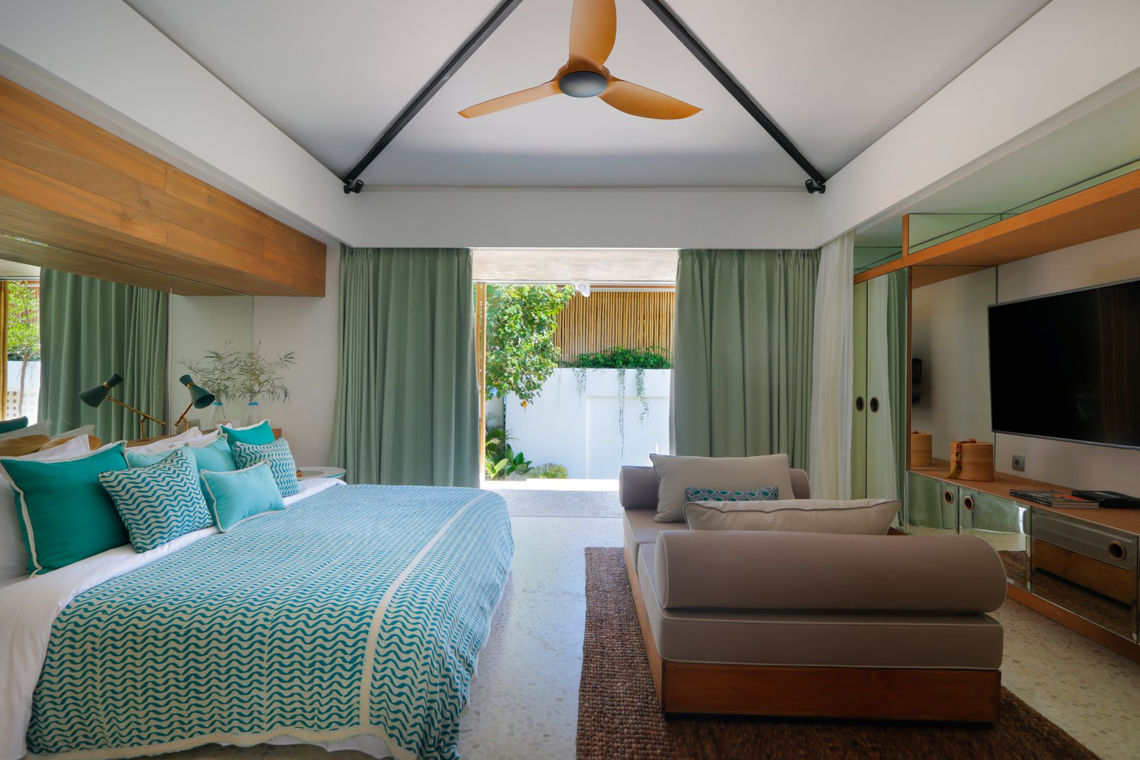Bedroom, Bed, Night Stands, Rug, Table, and Wardrobe Each bedroom opens to a terrace.    Best Bedroom Wardrobe Rug Photos from Fall in Love With Bali at This Tropical, Modern Retreat