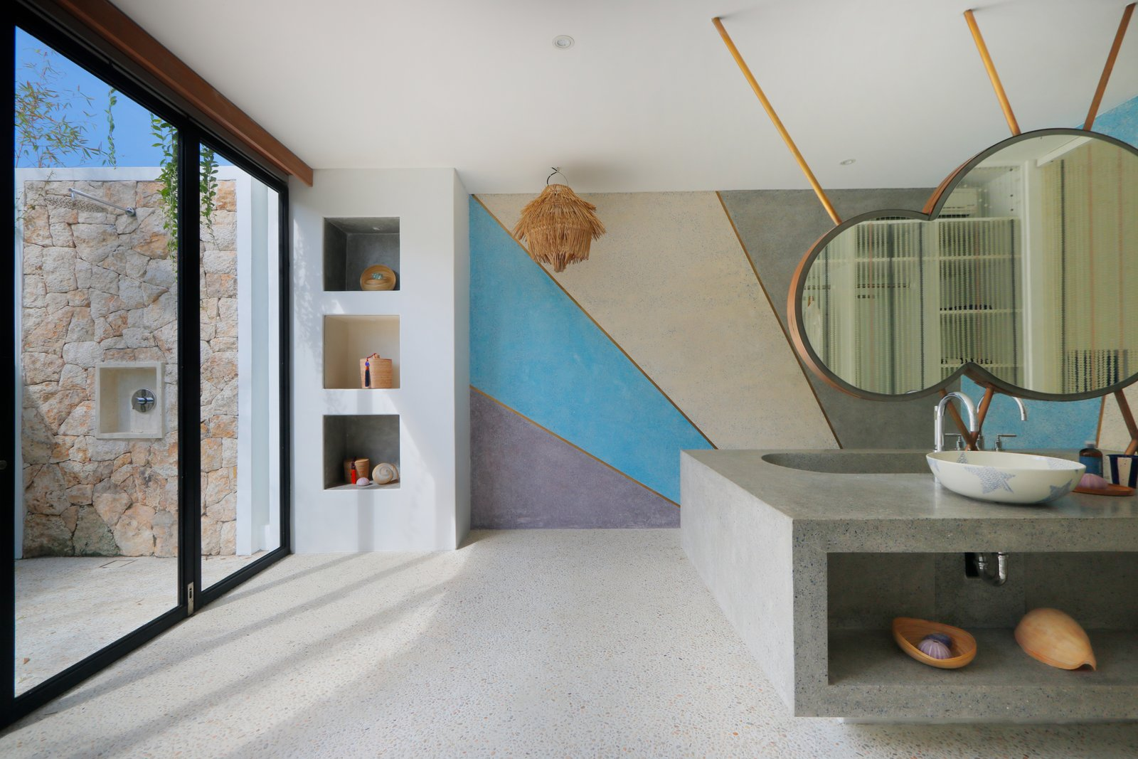 Bath Room, Vessel Sink, Recessed Lighting, and Alcove Tub A look at a bright and spacious bathroom with uniquely-shaped mirrors and a vibrant mural.    Photo 13 of 19 in Fall in Love With Bali at This Tropical, Modern Retreat