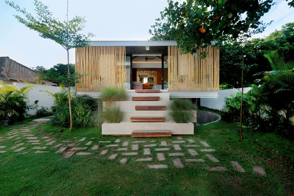 The separate volume complements the design of the main house, yet with more of a tropical, modern feel.