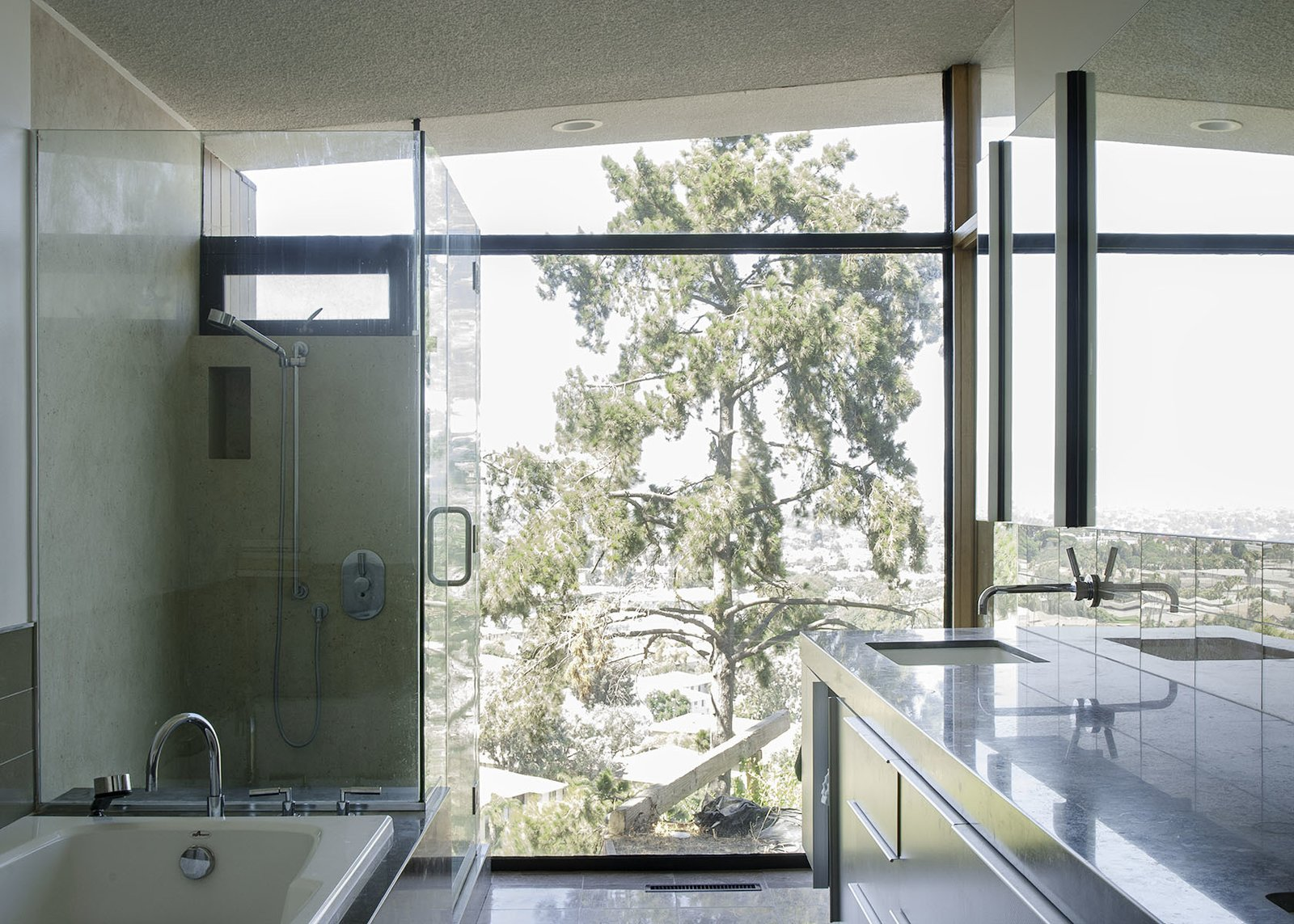 Bath Room, Alcove Tub, Recessed Lighting, Enclosed Shower, Undermount Sink, and Corner Shower Even the bathrooms give a sense of being nestled into the surrounding nature.  Photo 7 of 13 in A 1958 Midcentury With Stunning L.A. Views Lists For $2.2M