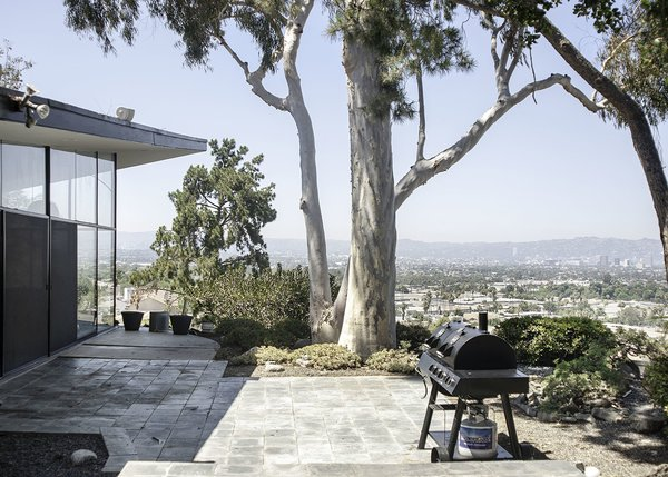This view of the patio captures the Waymire Residence's classic midcentury style, as the home appears to almost take flight from its hillside setting.