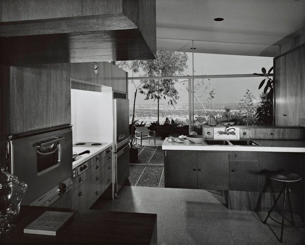 Kitchen, Cooktops, Ceiling Lighting, Wall Oven, Undermount Sink, Wood Cabinet, and Recessed Lighting The classic midcentury kitchen prior to updates.  Photo 12 of 13 in A 1958 Midcentury With Stunning L.A. Views Lists For $2.2M