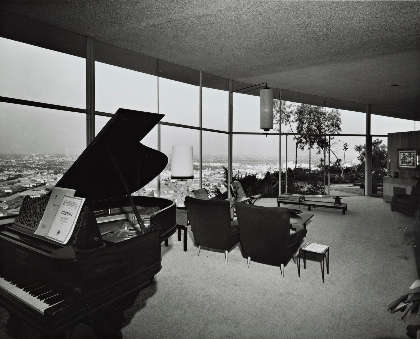 Living Room, End Tables, Table Lighting, Chair, Pendant Lighting, Coffee Tables, and Carpet Floor The living room as it originally appeared.  Photo 11 of 13 in A 1958 Midcentury With Stunning L.A. Views Lists For $2.2M