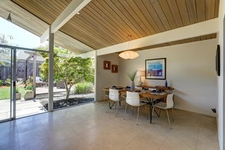 The dining area looks out over an exterior patio.