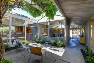 Flooded with natural light, this property offers a true indoor-outdoor living experience.