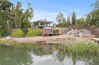 The home overlooks its own private sauna and slice of beach.