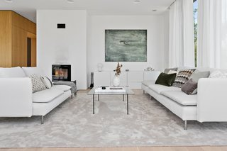 The cozy living area features a white-on-white palette.