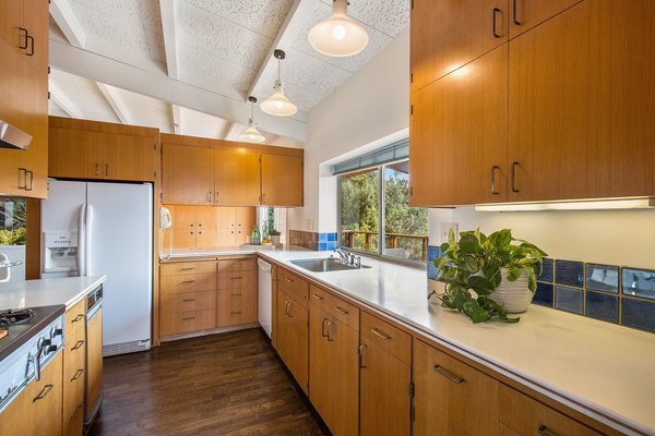 The original kitchen is simple and tasteful, yet also ripe for modern updates.