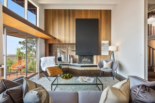 The living room is anchored by a statement fireplace.