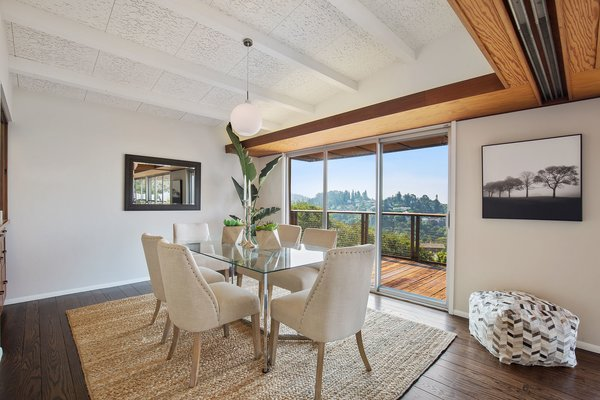 The dining nook sits right off the living room and also embraces striking views.