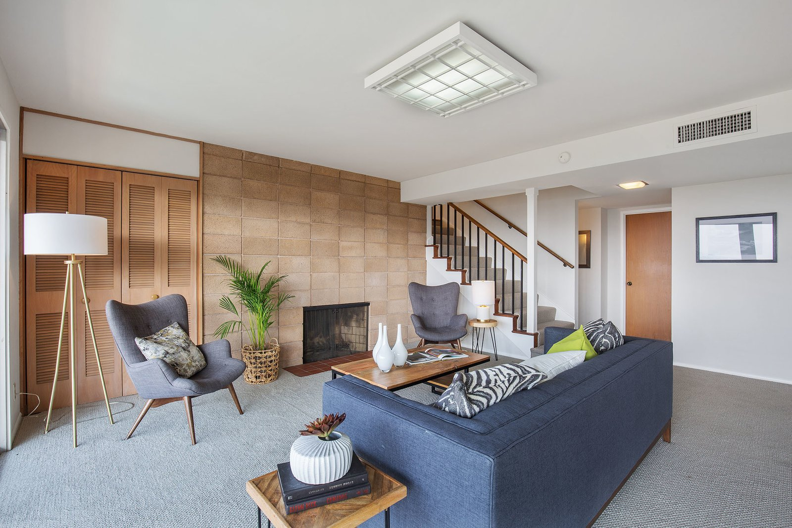 Living, Ceiling, Sofa, Chair, Standard Layout, Floor, Carpet, Coffee Tables, End Tables, and Table The residence also features a basement with an additional living room.     Best Living Standard Layout Carpet Photos from A Dreamy Midcentury in Oakland Is Seeking a New Owner For $1.4M