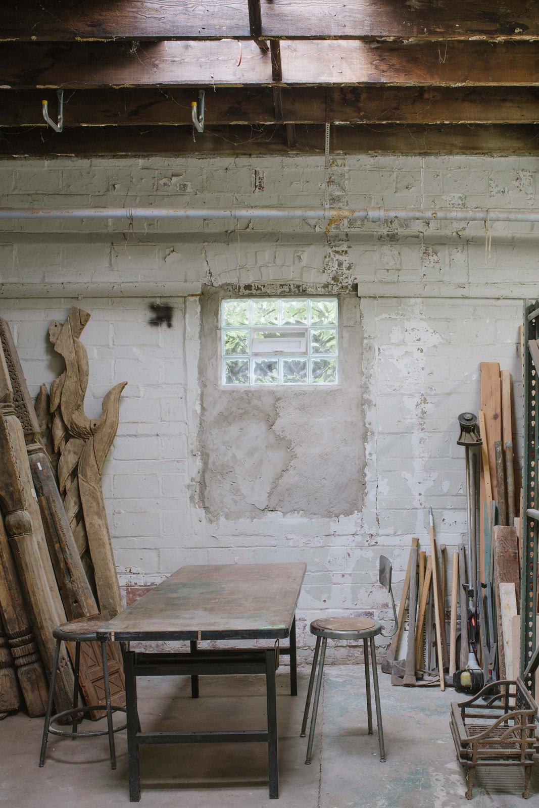 Shed & Studio In contrast, the Big Space has untouched and uninsulated walls. It is heated with an existing gas garage ceiling heater that is able to temporarily heat up quickly and as needed. The big garage/workshop also serves as a climatic buffer space to the Little Space.   Photo 8 of 10 in A 1920s Masonry Garage Is Reborn as a Flexible Live/Work Space